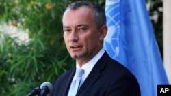 FILE - In a Monday, Sept. 25, 2017, photo, United Nations Special Coordinator for the Middle East Peace Process Nickolay Mladenov, attends a press conference at the UNSCO offices in Gaza City.