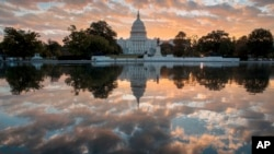 FILE - The Capitol at sunrise in Washington, Oct. 10, 2017. The crush of unfinished business facing lawmakers when they return to the Capitol this week would be daunting even if Washington were functioning at peak efficiency.