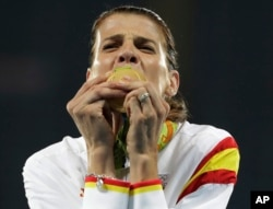 Spain's Ruth Beitia kisses her gold medal for the women's high jump during athletics competitions at the Summer Olympics inside Olympic stadium in Rio de Janeiro, Brazil, Aug. 20, 2016.