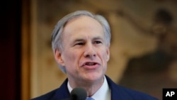 "Texas Gov. Greg Abbott welcomed the judicial ruling blocking President Barack Obama's order on immigration, saying that ""in Texas, we will not sit idly by while the president ignores the law and fails to secure the border,"" Feb. 17, 2015."