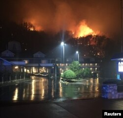 A wildfire burns on a hillside after a mandatory evacuation was ordered in Gatlinburg, Tennessee, in a Tennessee Highway Patrol picture released Nov. 30, 2016.