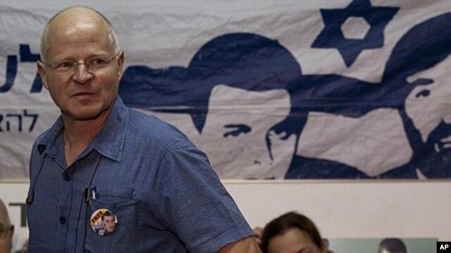 Noam, left, and Aviva Schalit, parents of captured Israeli soldier Gilad Schalit, sit in a protest tent set up outside the Prime Minister's residence in Jerusalem, October 11, 2011.