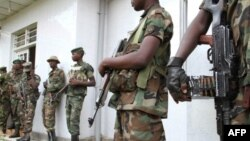 M23 rebels army keep security during a press conference at Bunagana, January 3, 2013
