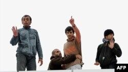 Sírios em Calais, norte da França (Foto de arquivo)