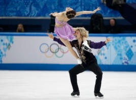 Meryl Davis and Charlie White of the U.S. compete during the figure skating ice dance free dance program at the Sochi 2014 Winter Olympics, Feb. 17, 2014.