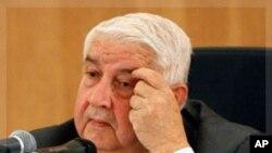 敘利亞外交部長穆阿利姆星期一在大馬士革的記者會上