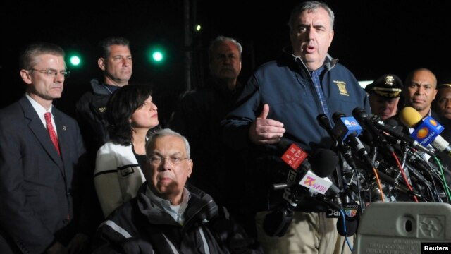 Boston Police Commissioner Ed Davis (CR) stands next Boston Mayor Tom Menino (bottom) as he answers questions about the capture of Dzhokhar Tsarnaev, the second suspect in the Boston Marathon bombing, in Watertown, Massachusetts, April 19, 2013.