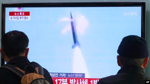 FILE - People watch a TV report on North Korea's missile test at Seoul Railway Station in Seoul, South Korea, March 4, 2014.