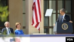 Former president George W. Bush, former first lady Laura Bush and President Obama share a lighter moment during the dedication of the Bush Presidential Library and Museum, April 25, 2013.