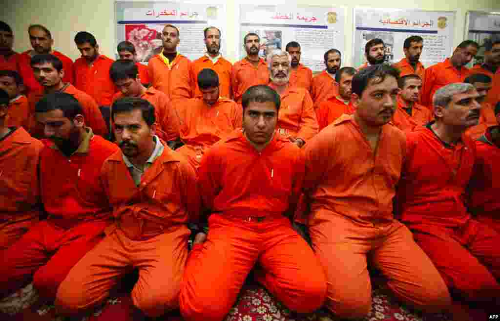 Detainees are displayed for the media during a news conference by Iraq's Interior Minister in Baghdad December 2. Security forces arrested 39 al Qaeda militants, including the group's leadership in Anbar province and one of its top officers in Iraq, in ra