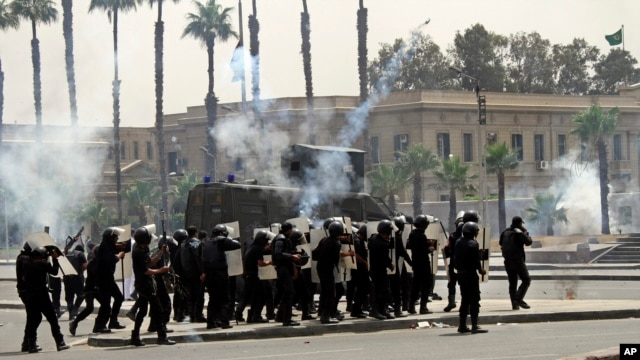 Riot police fire tear gas towards supporters of the Muslim Brotherhood during a demonstration at Cairo University, Egypt, May 20, 2014.