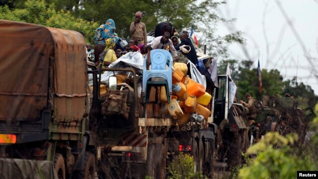 Muslims fleeing sectarian violence are on top of a truck with their belongings -- on the road between Bangui and Sibut -- on a convoy being escorted by French peacekeepers to the south eastern town of Bambari, Central African Republic, April 20, 2014.