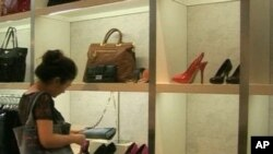 Chinese shopping looking at luxury goods (file photo)