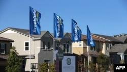 A sign advertising new homes is posted at a housing development in Dublin, California.