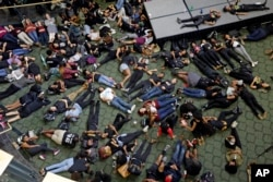 Students at the University of North Carolina-Charlotte hold a vigil by lying on the floor of the student union following Tuesday's police fatal shooting of Keith Lamont Scott at The Village at College Downs apartment complex in Charlotte, N.C., Sept. 21,
