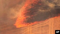 This aerial image made from video provided by FOX 12 News shows a grassland fire burning near The Dalles, Ore., July 18, 2018. The fast-moving deadly fire fueled by gusting winds in the Pacific Northwest forced dozens of households to evacuate and prompted Oregon Gov. Kate Brown to declare a state of emergency Wednesday.