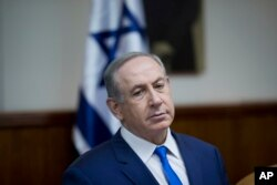 Israeli Prime Minister Benjamin Netanyahu attends the weekly cabinet meeting at his office in Jerusalem, Jan. 8, 2017.