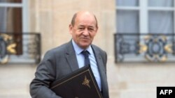 FILE - French Defense Minister Jean-Yves Le Drian at Elysee presidential Palace, Feb. 6, 2013.