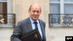 FILE - French Defense Minister Jean-Yves Le Drian at Elysee presidential Palace.