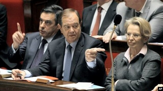 French PM Francois Fillon, left, with Parliamentary Relations Minister Patrick Ollier, centre, his partner Foreign Affairs Minister, Michele Alliot-Marie during the government questions at the French Parliament in Paris, February 9, 2011.