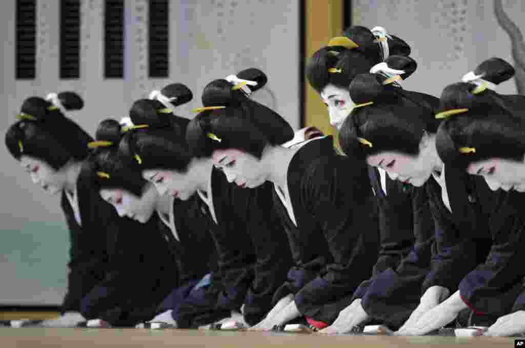 "Japanese traditional female entertainers, or geisha, prepare for the early ""Azumaodori"" performance, at Shimbashi Enbujo Theater in Tokyo."