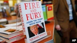 "FILE - The three remaining copies of the book ""Fire and Fury: Inside the Trump White House"" by Michael Wolff are displayed at a Barnes & Noble store in Newport, Kentucky, Jan. 5, 2018."