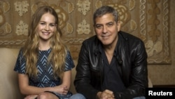 "Cast members George Clooney and Britt Robertson pose for a portrait while promoting their upcoming movie ""Tomorrowland"" in Beverly Hills, California, May 8, 2015."