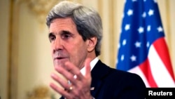 U.S. Secretary of State John Kerry speaks during a news conference at the U.S. ambassador's residence in Paris, March 30, 2014.
