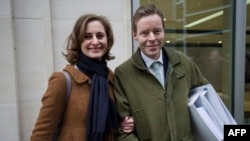 George Bingham, the only son of infamous British aristocrat Lord Lucan, and his wife, Anne-Sofie Foghsgaard, leave the High Court in London, Feb. 3, 2016. A judge issued a death certificate for Lord Lucan, four decades after he disappeared.