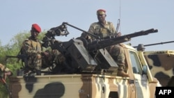 FILE - A convoy of Cameroonian soldiers reinforces its military front against Nigerian Islamist group Boko Haram.