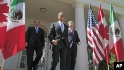 U.S. President Barack Obama, (C), Canada's Prime Minister Stephen Harper (R), and Mexico's President Felipe Calderon (L) walk out of the Oval Office before a joint press conference in the Rose Garden of the White House in Washington, April 2, 2012.