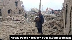 پولیس فاریاب گفته است که این عکس پس از انفجار در ولسوالی دولت آباد گرفته شده است