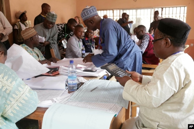 Electoral officials compile voting results at a collation center in Yola, in Nigeria, Feb. 24, 2019.