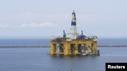 FILE - A Shell Oil Company drilling rig.