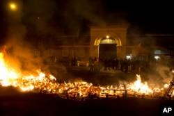 FILE - Prison guards protest by burning pallets outside Fresnes prison, outside Paris, France, Jan. 24, 2018.