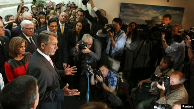 U.S. Speaker of the House John Boehner (2nd L) speaks to the media with other Republican House members in Washington, Oct. 10, 2013.