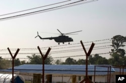 FILE - A helicopter with an advisory squad lands near newly built repatriation camps for Rohingya refugees expected to arrive on January 24, 2018 in Taungpyo, Myanmar to return from Bangladesh.