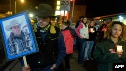 A group of about 20 people held a candlelight celebration for Robert Finicum, who was killed during an arrest Tuesday near the Malheur National Wildlife Refuge, in Burns, Ore., Jan. 27, 2016.