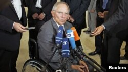 Germany's Finance Minister Wolfgang Schaeuble talks to the media before attending a eurozone finance ministers meeting in Luxembourg, June 21, 2012.