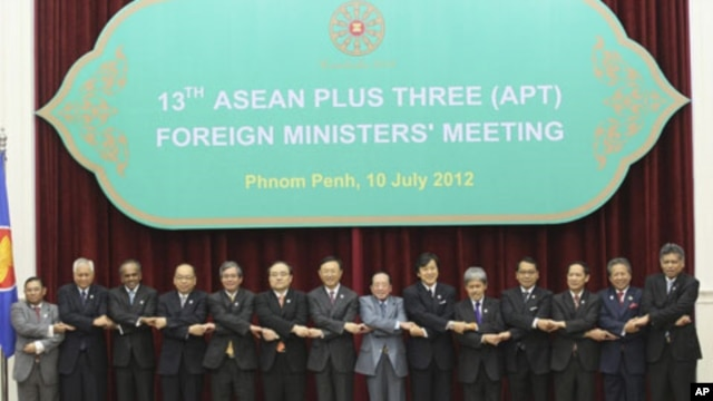 ASEAN countries' foreign ministers join their hands during a photo session at the 45th Association of Southeast Asian Nations (ASEAN) Foreign Ministers' Plus three Meeting in Phnom Penh, Cambodia, Tuesday, July 10, 2012.