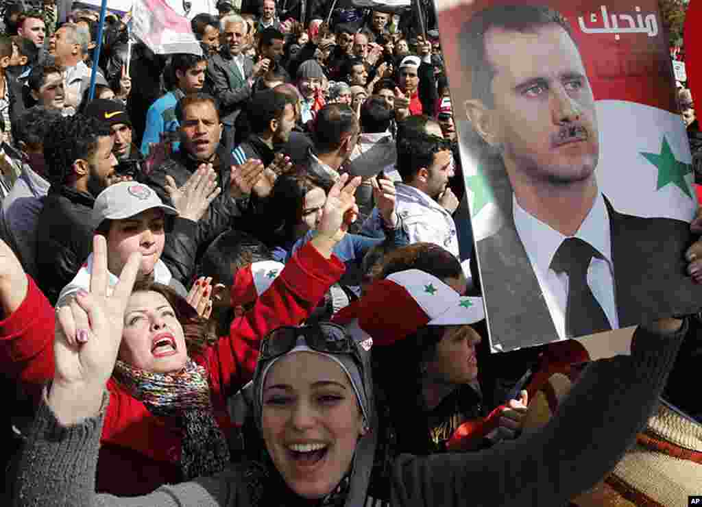 Supporters of Syrian President Bashar al-Assad attend a rally at Umayyad square in Damascus, March 15, 2012. (Reuters)