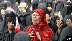 A female anti-government protestor, center, reacts while chanting prayers along with other women during a demonstration demanding the resignation of Yemeni President Ali Abdullah Saleh, in Taiz, Yemen, Friday, July 1, 2011
