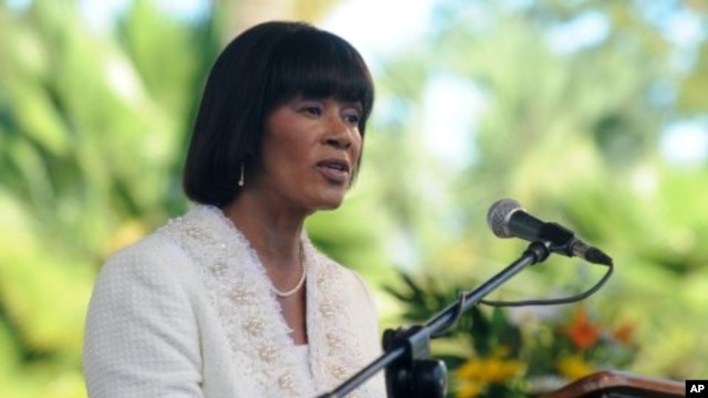 FILE - Jamaica's Prime Minister Portia Simpson Miller delivers her inaugural speech after being sworn in at King's House in Kingston, Jan. 5, 2012.