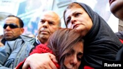 The mother, right, of photographer Nadhir Ktari, who disappeared with fellow journalist Sofiene Chourabi in Libya in September, attends a demonstration held in solidarity with the missing pair in Tunis, Jan. 9, 2015.