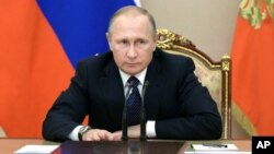 Russian President Vladimir Putin heads a meeting on the budget in Moscow's Kremlin, Russia, Sept. 26, 2016.