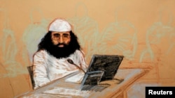 FILE - Walid bin Attash appears at his arraignment as an accused 9-11 co-conspirator in this courtroom sketch reviewed and approved for release by a U.S. military security official, at Guantanamo Bay Navy Base, Cuba, May 5, 2012.