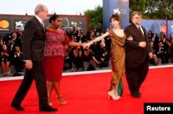 "Director Guillermo del Toro, right, poses with actors Sally Hawkins, 2nd right, Richard Jenkins' left, and Octavia Spencer during a red carpet event for the movie ""The Shape of Water"" at the 74th Venice Film Festival in Venice, Italy, Aug. 31, 2017."
