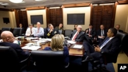 President Barack Obama is briefed on the situation on the Korean peninsula in the White House Situation Room, Nov. 23, 2010.