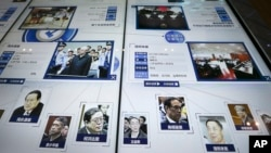 "A display showing images of individuals convicted on corruption charges including Bo Xilai, bottom second right, Zhou Yongkang, bottom left, and other senior officials, at the China Court Museum in Beijing. Chinese president Xi Jinping has continued his campaign against ""tigers and flies."""