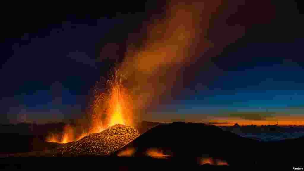Molten lava erupts from the Piton de la Fournaise, one of the world's most active volcanoes on the French Indian Ocean Reunion Island, Aug. 1, 2015.